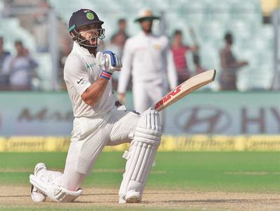 Kohli slams 50th ton as Sri Lanka hang on for draw