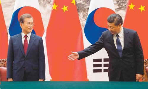 China, South Korea look to defuse tensions, improve ties