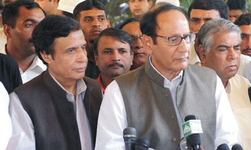 Shujaat, Elahi appear before NAB in corruption reference