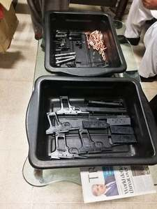 Four pistols, eight magazines and some bullets were found from the suspect's possession. —Photo courtesy ASF