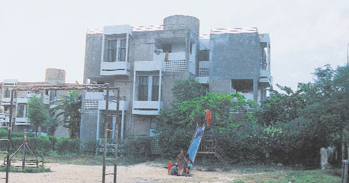 Deadly cache: Rana Mohammad Naveed's flat in ADBP Colony (above) was used to store weapons meant for the December 25 attack