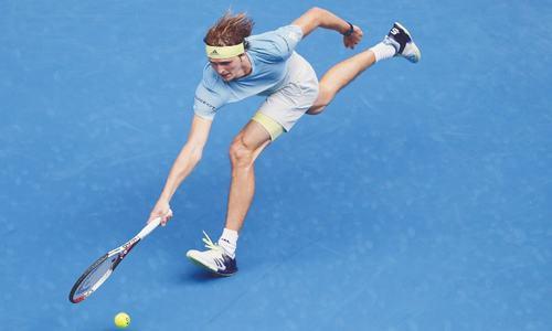 Federer steams on as Sharapova grinds to halt