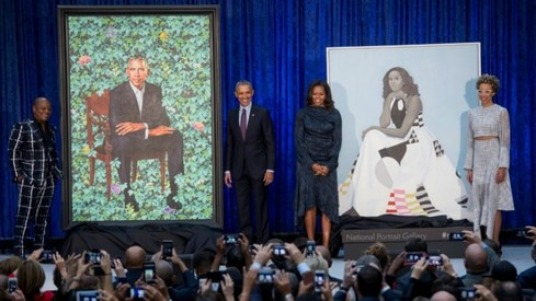Obamas reveal unconventional portraits in Washington