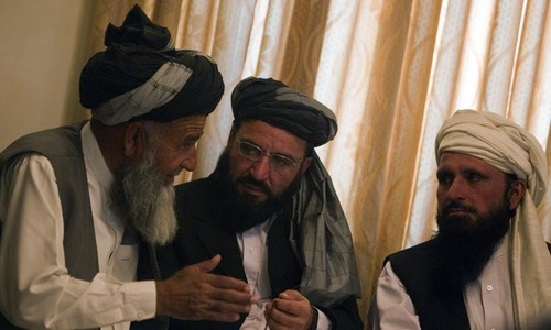 Afghan officials and Taliban talk despite wave of violence