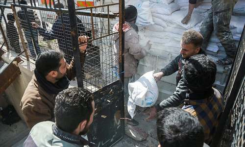 Food arrives in Syria's battered Eastern Ghouta
