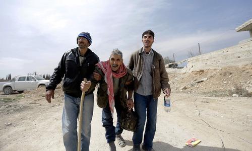 Thousands flee Syria rebel enclave after month-long bombardment