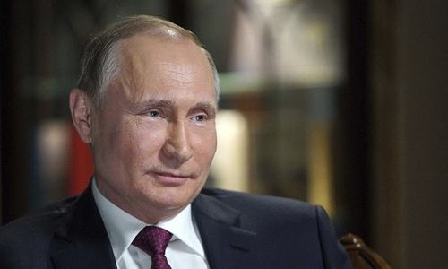 Vladimir Putin eyes fourth term as Russians vote and opposition cries foul