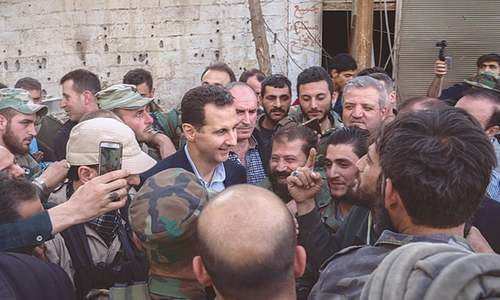 Assad visits troops on Ghouta's frontline