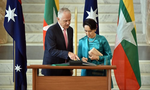 Myanmar's Suu Kyi receives guard of honour in Australia amid protests