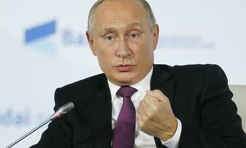 Putin predicts global chaos if West hits Syria again
