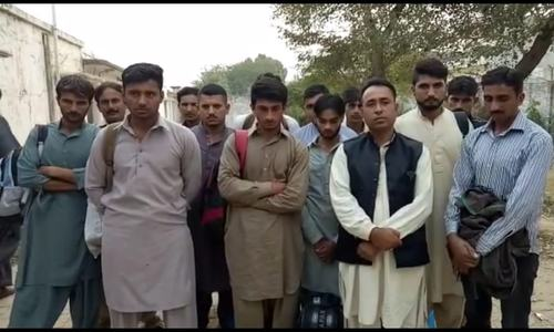 A group of would-be illegal immigrants apprehended by the FIA at Kharian bus stand before starting their journey towards Quetta to cross Pakistan-Iran border. — Waseem Ashraf Butt