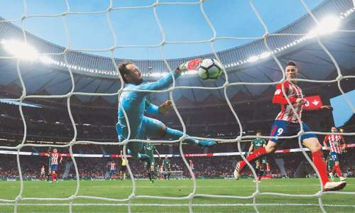 Atletico held by Betis ahead of visit to Arsenal