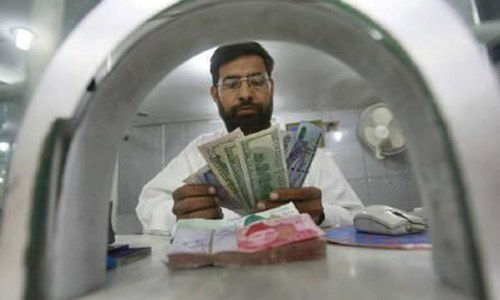 Rupee trades flat against dollar