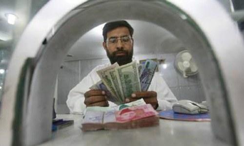Rupee trades flat against dollar