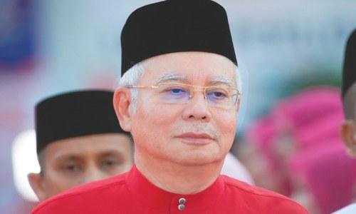 Malaysia bars scandal-ridden ex-leader Najib Razak from leaving country