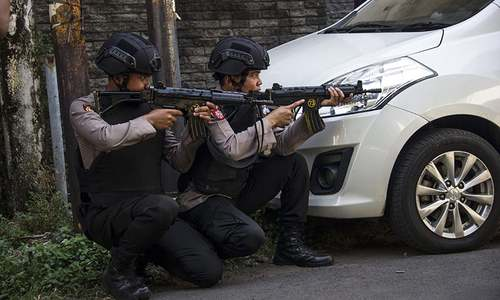 Suicide bombings in Indonesia are the work of two families, police say after attack on HQ