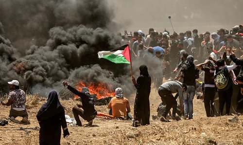 Gaza death toll rises to 60 as Palestinians gather for fresh protests against Israel
