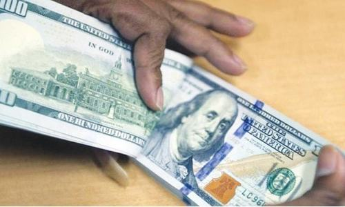 Reserves fall, dollar edges up