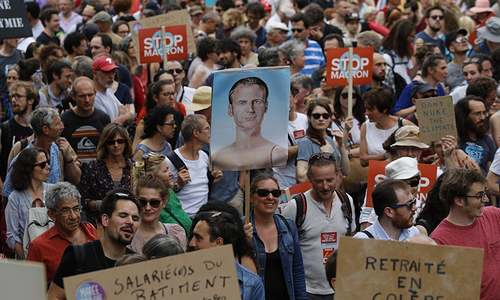 Thousands march in France against Macron reforms