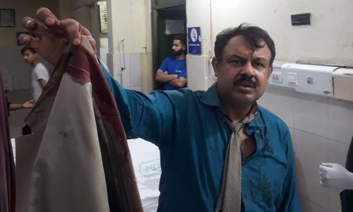 Journalist Asad Kharal beaten up by masked men in Lahore