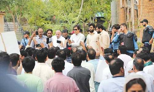PTI workers stage sit-in outside Banigala as Khan gets a taste of his own medicine