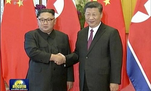 North Korea's Kim briefs China's Xi on Trump summit