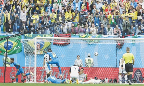 Coutinho, Neymar strike late to give Brazil first win
