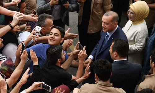 6 arrested in Turkey for 'insulting Erdogan on social media' as country goes to polls