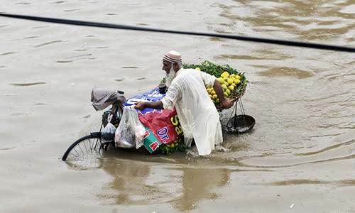 In pictures: Heavy downpour causes streets to flood in Lahore