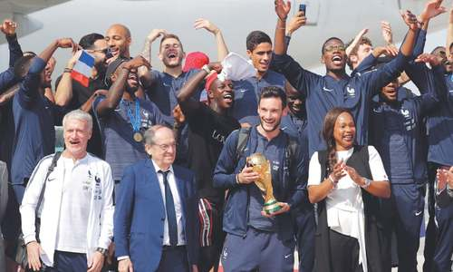 World Cup winners get red carpet welcome on return