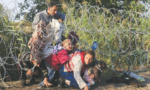 Hungary follows US to pull out of UN migration pact