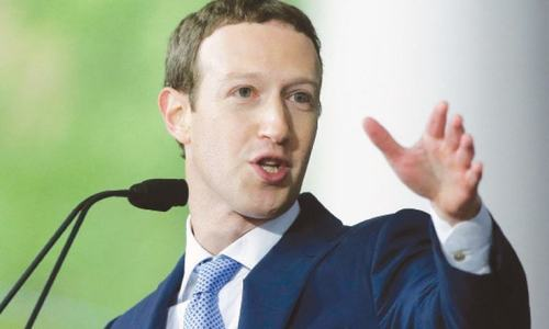 Facebook trying to reshape itself, Zuckerberg tells Senators