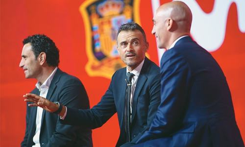 New Spain coach Enrique promises 'evolution, not revolution'
