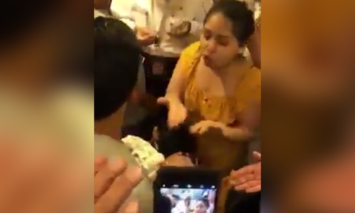 Video of mother demanding PIA crew to open plane door for 'unconscious' baby goes viral