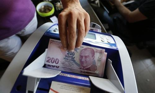 Turkish lira weakens against dollar, minister warns on sanctions