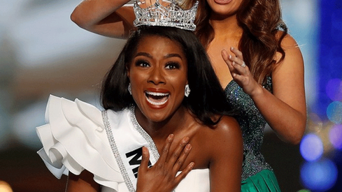 I'm happy I didn't have to wear a swimsuit to win; I'm more than just that, says Miss America