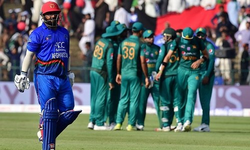 Afghan batsman Mohammad Shahzad leaves the pitch after being dismissed by Pakistan's Mohammad Nawaz  — AFP
