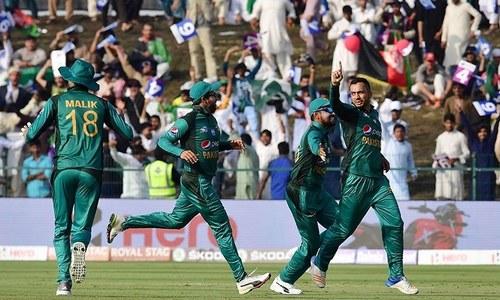 Nawaz (R) celebrates after he dismissed Afghan batsman  Mohammad Shahzad — AFP)