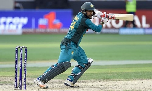 Sarfraz Ahmed plays a shot during the one day international (ODI) Asia Cup cricket match between Pakistan and India — AFP