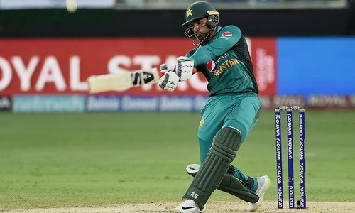 Asif Ali plays a shot during the Asia Cup cricket match between Pakistan and India. — AFP