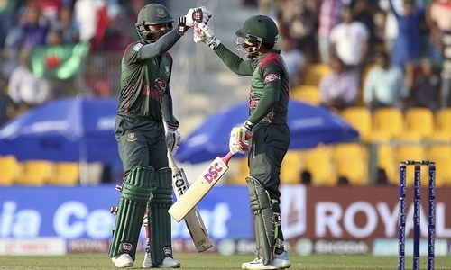 Bangladesh's Mohammad Mithun, left, congratulates teammate Mushfiqur Rahim on scoring fifty runs — AP
