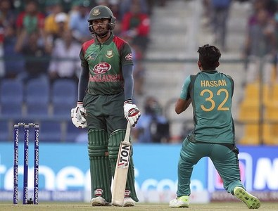 Mithun, left, looks on as Hasan Ali, right, takes the catch to dismiss him. — AP