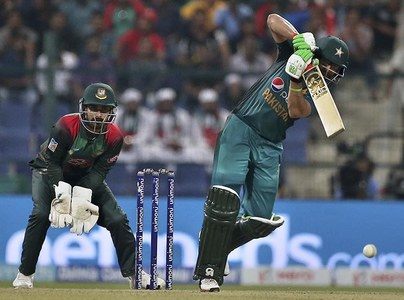 Imam-ul-Haq, right, bats during the Asia Cup match between Pakistan and Bangladesh in Abu Dhabi. — AP