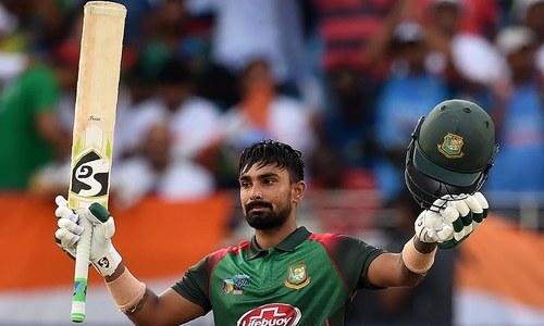 Bangladesh batsman Liton Das celebrates after scoring a century. — AFP