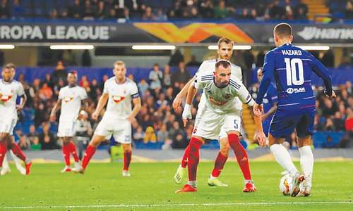 LONDON: Vidi FC players look on Chelsea's Eden Hazard attempts to dribble past them during their Group 'L' match at Stamford Bridge.—Reuters