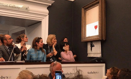 Banksy painting Girl With Balloon self-destructs moments after being sold for $1.4 million