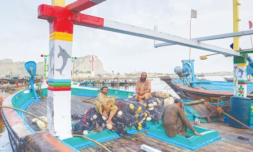 Fishermen at the Gwadar fish market which was relocated to allow for the expansion of the Gwadar port | Kohi Marri
