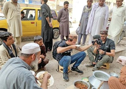 Thai travel blogger Mark Weins enjoys chapli kebabs in Peshawar