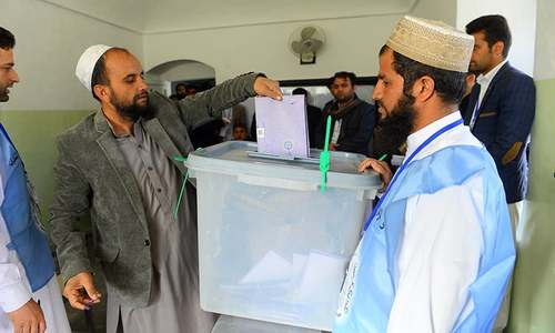 Afghans brave militant threat to vote in delayed election