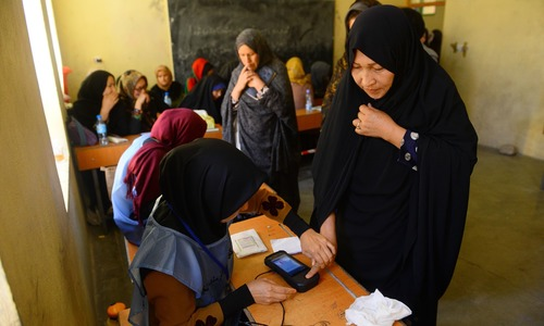 Chaotic Afghan parliamentary elections enter second day after attacks, technical issues